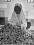 Moslem Woman Shopping for Potatoes Photographic Print by John Phillips