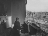 Woman Sitting in the Remains of Her Tornado Wrecked Home Premium Photographic Print by Stan Wayman