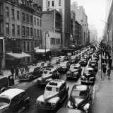 Bumper-To-Bumper Traffic of Taxicabs and Cars Moving Toward 6th Avenue on 51 Street Photographic Print by William C. Shrout