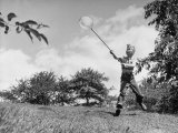 Young Entomologist Pursuing His Hobby with a Butterfly Net Premium Photographic Print by Al Fenn