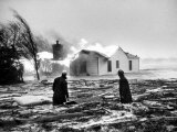 Two People Watching House Burn in Aftermath of Hurricane Hazel Photographic Print by Hank Walker