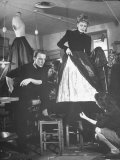 Jacques Fath Watching as the Tailor Hymns the Loose Ends at the Bottom of the Dress Premium Photographic Print by Nina Leen