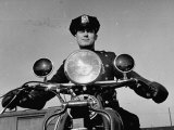 NYPD Motorcycle Cop Francis Kennedy Patrolling the Streets on His Bike Photographic Print by Carl Mydans