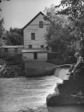 Man Fishing Beside a Waterfall and a 100 Year Old Mill Photographic Print by Bob Landry