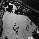Boys Playing Game of Punch Ball Slap Ball Down by the Docks Photographic Print by Andreas Feininger