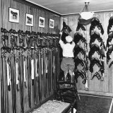 Man Checking Equipment Inside a Stable&#39;s Tack Room Photographic Print by Alfred Eisenstaedt