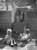 Children Playing in a Toy Made by Charles Eames Premium Photographic Print by Allan Grant