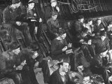 Relief Workers Eating Lunch in Steel Tunnel Used to Divert the Missouri River, Fort Peck Dam Premium Photographic Print by Margaret Bourke-White