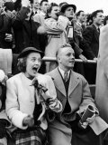 Coed Merrilyn Olson and Date Brooks Conrad Watching Wisconsin-Marquette Football Game Premium Photographic Print by Alfred Eisenstaedt