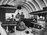 Interior View of Steel Underground Radiation Fallout Shelter Where Couple Relaxes with 3 Children Photographic Print by Walter Sanders