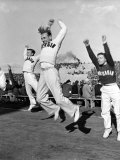 Male Cheerleaders in Action at Wisconsin-Marquette Football Game Premium Photographic Print by Alfred Eisenstaedt