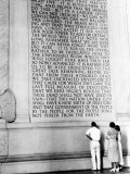 Visitors Reading the Inscription of Pres. Abraham Lincoln's Gettysburg Address, Lincoln Memorial Premium Photographic Print by Thomas D. Mcavoy