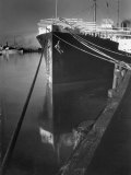 Oil Tanker Tied Up at Dock While it Is Being Loaded with Barrels of Oil Premium Photographic Print by Margaret Bourke-White