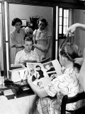 NY Professional Grooming Consultant Working on a Stephens Student's Hair Premium Photographic Print by Alfred Eisenstaedt