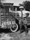 Polo Player Checking the Mallets Fotoprint van Alfred Eisenstaedt