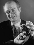 Dr. Linus Pauling Holding a Wooden Model of the Molecular Structure of Protein Premium Photographic Print by Ralph Morse