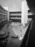 View of the Outdoor Swimming Pool of the Beverly Carlton Hotel Premium Photographic Print by Allan Grant