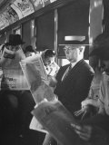 Commuters Sitting on a Train and Reading the Chicago Tribune Premium Photographic Print by Charles E. Steinheimer