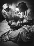 African American Midwife Maude Callen Delivering a Baby Premium Photographic Print by W. Eugene Smith