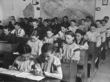 Young Czech Boys and Girls Working on their Lessons in Classroom at Village Public School Reproduction photographique sur papier de qualité par Margaret Bourke-White