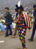 Paul Foster Walking During the Woodstock Music and Art Festival Premium Photographic Print by Bill Eppridge
