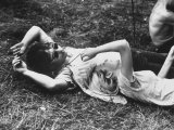 Young Couple Relaxing During Woodstock Music Festival Photographic Print by Bill Eppridge