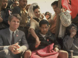 Robert F. Kennedy Sitting Next to Cesar Chavez During Rally for the United Farm Workers Union Premium Photographic Print by Michael Rougier