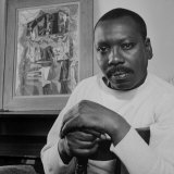 Artist Jacob Lawrence Sitting in Front of One of His Paintings Premium Photographic Print by Robert W. Kelley