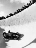 Good of Cresta Run, Bobsled Run, Coasting around Sunny Bend as People Peer from Above the Track Photographic Print by Alfred Eisenstaedt