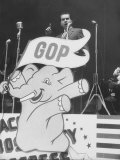 GOP Candidate Richard M. Nixon Campaigning with the GOP Poster Profiling in Front of Him Premium Photographic Print by Hank Walker
