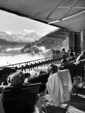 Guests at Fashionable Winter Resort Napping and Sunbathing on Hotel Terrace after Lunch Premium Photographic Print by Alfred Eisenstaedt