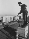 East German Chimney Sweeper at Work in a New Housing Development Premium Photographic Print by Ralph Crane
