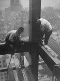Workmen Attaching Steel Beams High Above Street During Construction of Manhattan Company Building Fotoprint van Arthur Gerlach