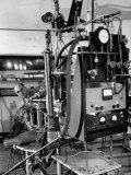 Italian Physicist Enrico Fermi Peering Out from Behind Large, Complicated Machinery in Laboratory Premium Photographic Print by Ralph Morse