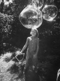 Girl Playing with Soapy Solution Large Ring Bubbles Ring in Yard Premium Photographic Print by Stan Wayman