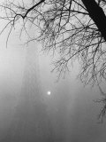 Paris Fog with Eiffel Tower Faintly Seen Premium Photographic Print by Thomas D. Mcavoy