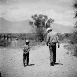 Rancher James A. Shugart Walking a Dusty Road with Son James Jr Photographic Print by Allan Grant