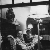 Man Reading the Newspaper While His Wife Knits, from Essay, An American Block Photographic Print by Alfred Eisenstaedt
