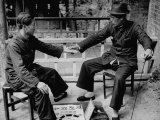 Soothsayer in a Small Chinese Village Telling Fortunes by Palmistry Premium Photographic Print by Mark Kauffman