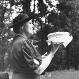 Mrs. Ernest Humphrey Daniels Offering Cake at Bake Sale Held, American Federation of Women's Clubs Photographic Print by David Scherman