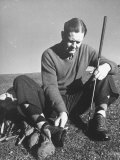 Golfer Byron Nelson Cleaning the Cleats on His Shoes Premium Photographic Print by Gabriel Benzur