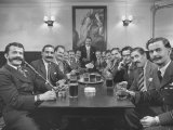 Members of Handlebar Club Sitting at Table and Having Formal Beer Session Reproduction photographique sur papier de qualité par Nat Farbman