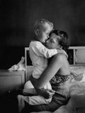 Young Mother Hugging One of Her Sons Premium Photographic Print by Mark Kauffman