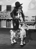 Chimpanzee Riding a Horse Premium Photographic Print by Wallace Kirkland