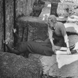 Woman Kissing the Blarney Stone Photographic Print by Hans Wild
