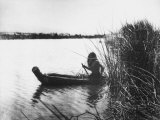 Pomo Indian Poling His Boat Made of Tule Rushes Through Shallows of Clear Lake, Northen California Photographic Print by Edward S. Curtis