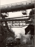 Steaming Hot Steel Slag Being Poured into Freight Cars on Railroad Siding at Steel Plant Premium Photographic Print by Margaret Bourke-White