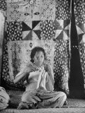 Woman Sewing in Her House in Front of a Tapa Screen Premium Photographic Print by Eliot Elisofon