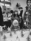 Little Boy Looking at Train Set in Moscow Department Store Photographic Print by James Whitmore