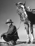 Man Sitting Holding His Horses Reins Premium Photographic Print by Loomis Dean